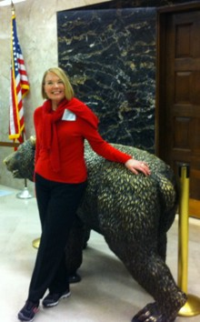 Laurie Edwards-Tate at California's State Capitol greeted by our California State grizzly bear.