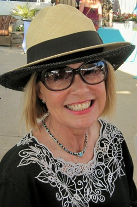 We always knew she wears more than one hat....Laurie Edwards-Tate adorned with her husband Bill Tate's Panama hat atop her own.