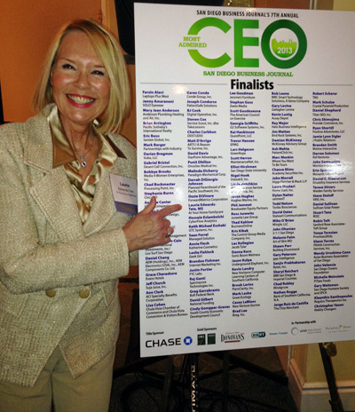 "Laurie Edwards-Tate showcasing the CEO poster of nominees, and exclaiming:  ""Finally, I have found myself!"""