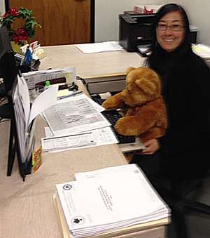 Christina Meade mentoring her Caring Bear to perform new data entry skills!