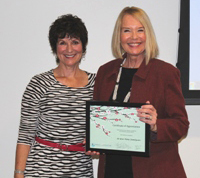 "Laurie Edwards-Tate, President and Founder of At Your Home Familycare (right) receiving a ""Year Round Corporate Partner"" award from Lorie VanTilburg, Executive Director, Southern Caregiver Resource Center"