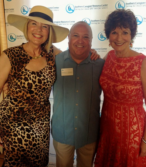 Laurie Edwards-Tate President and CEO of At Your Home Familycare (left) sharing in the excitement of Southern Caregiver's Resource Center 22nd Annual Bastille Day event with Roberto Velasquez, SCRC Development Director (center) and Lorie Van Tilburg, SCRC Executive Director (right).